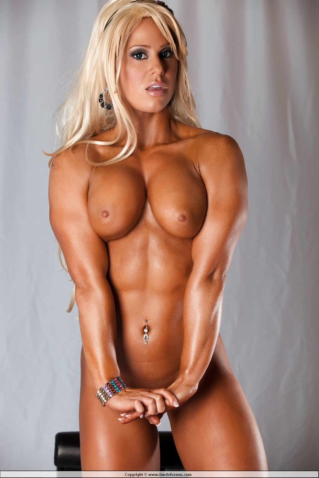Huge Boobs Babe Shows Her Naked Muscular Body