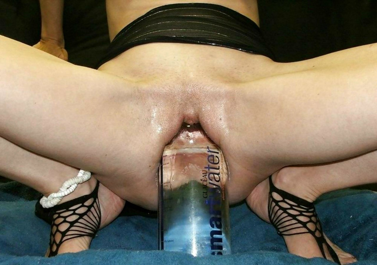 Bizarre pussy insertion photo that shows a closeup look inside of a girls cunt