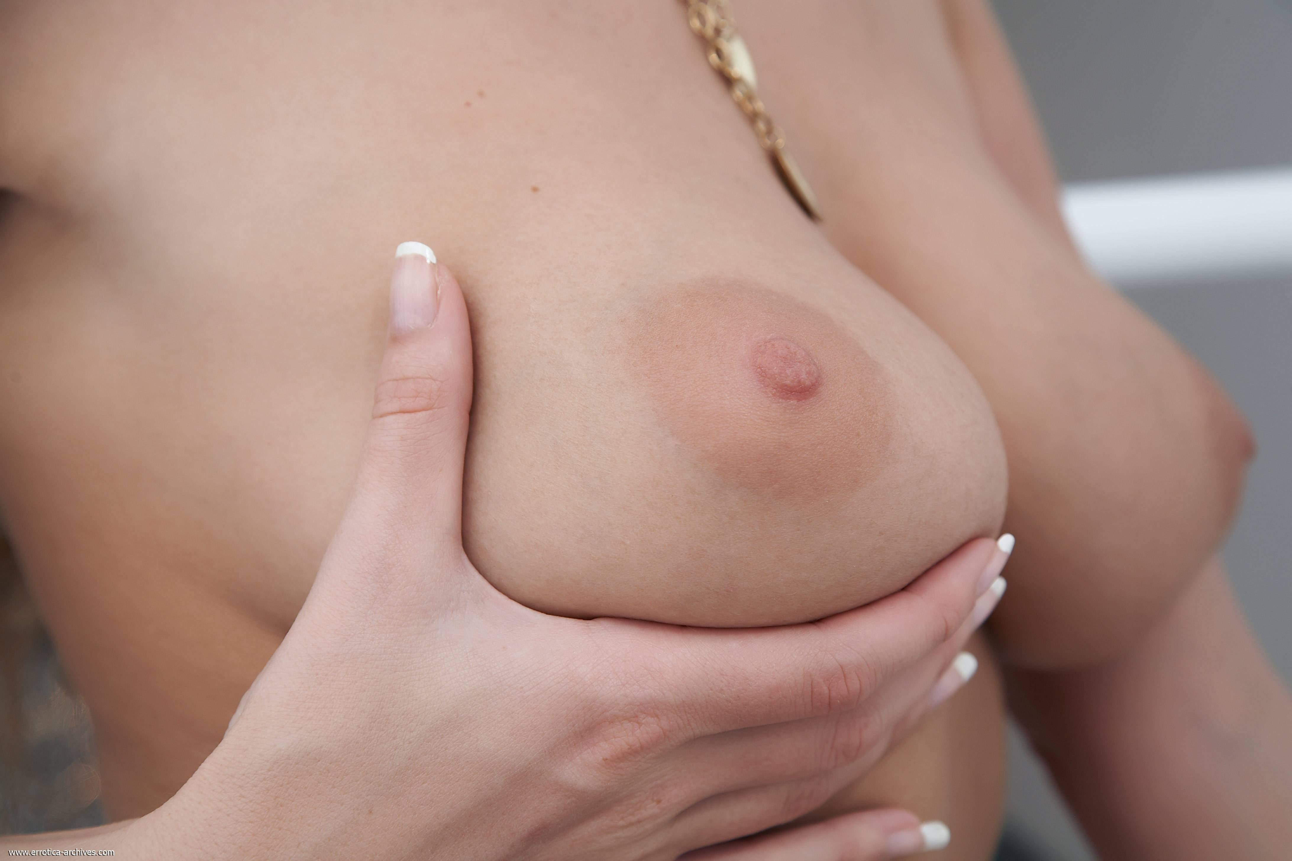 Woman crushes objects using her breasts