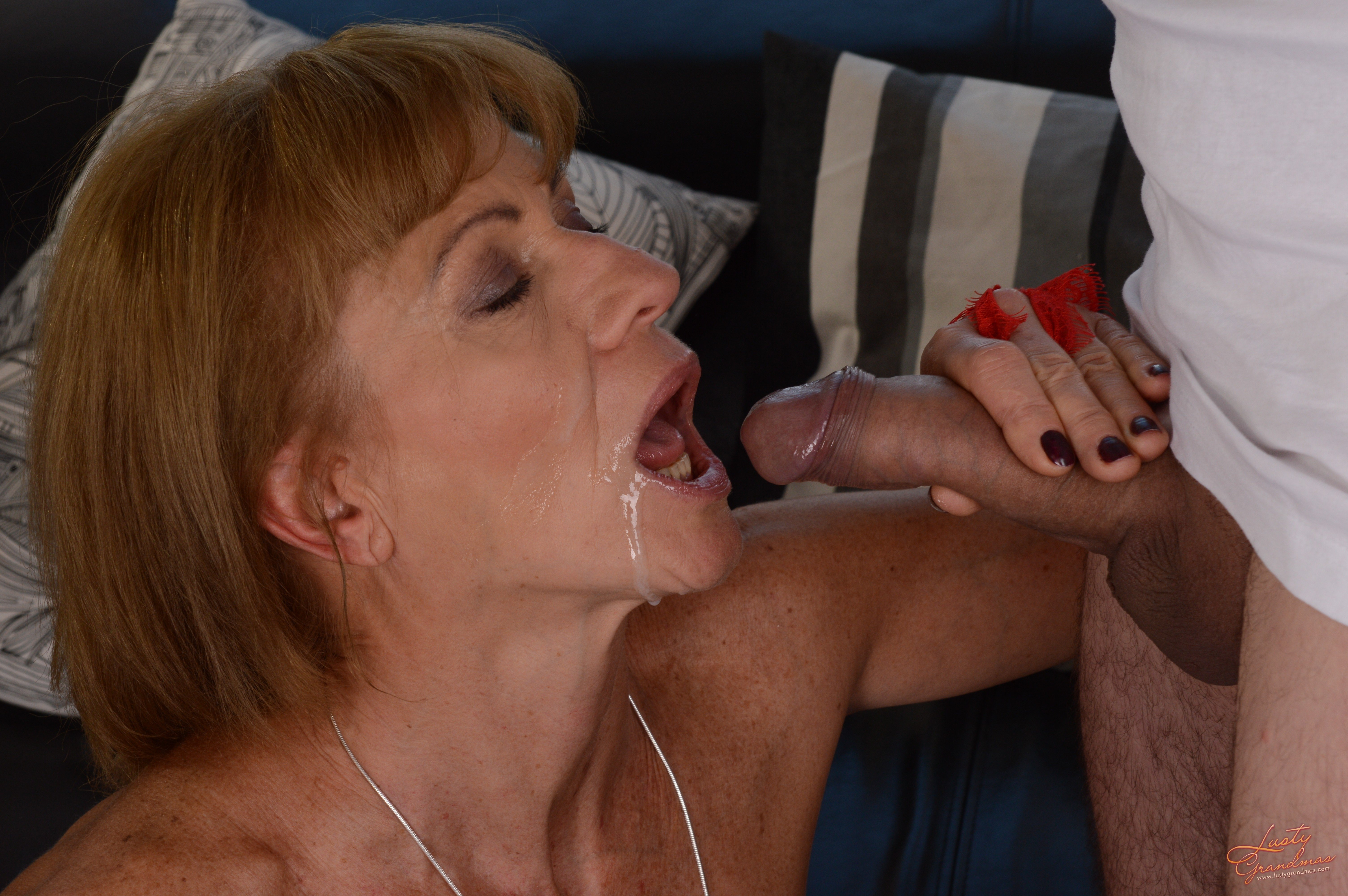 Mature stepmother gives stepson a slobbery blowjob