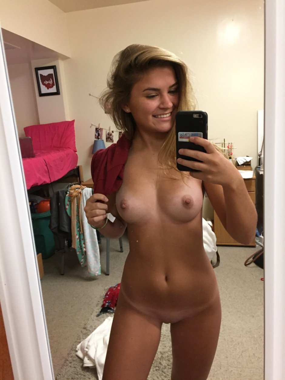 Sexy milf with gorgeous boobs shows us her hot lingerie in this naked selfie